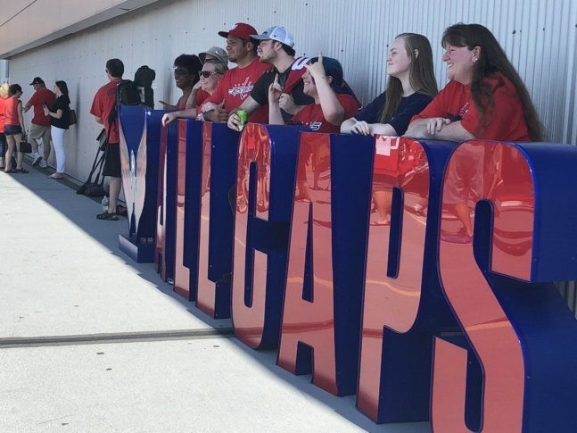 Fans rocked the red on Saturday at Fanfest for a picture with the Stanley  Cup and a chance to get a peek at the team s development camp scrimmage at  Kettler ... abeba42a883a
