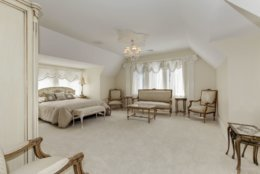 Three of the seven bedrooms are master suites with fireplaces. The main suite has his-and-her baths. (Courtesy Long & Foster)
