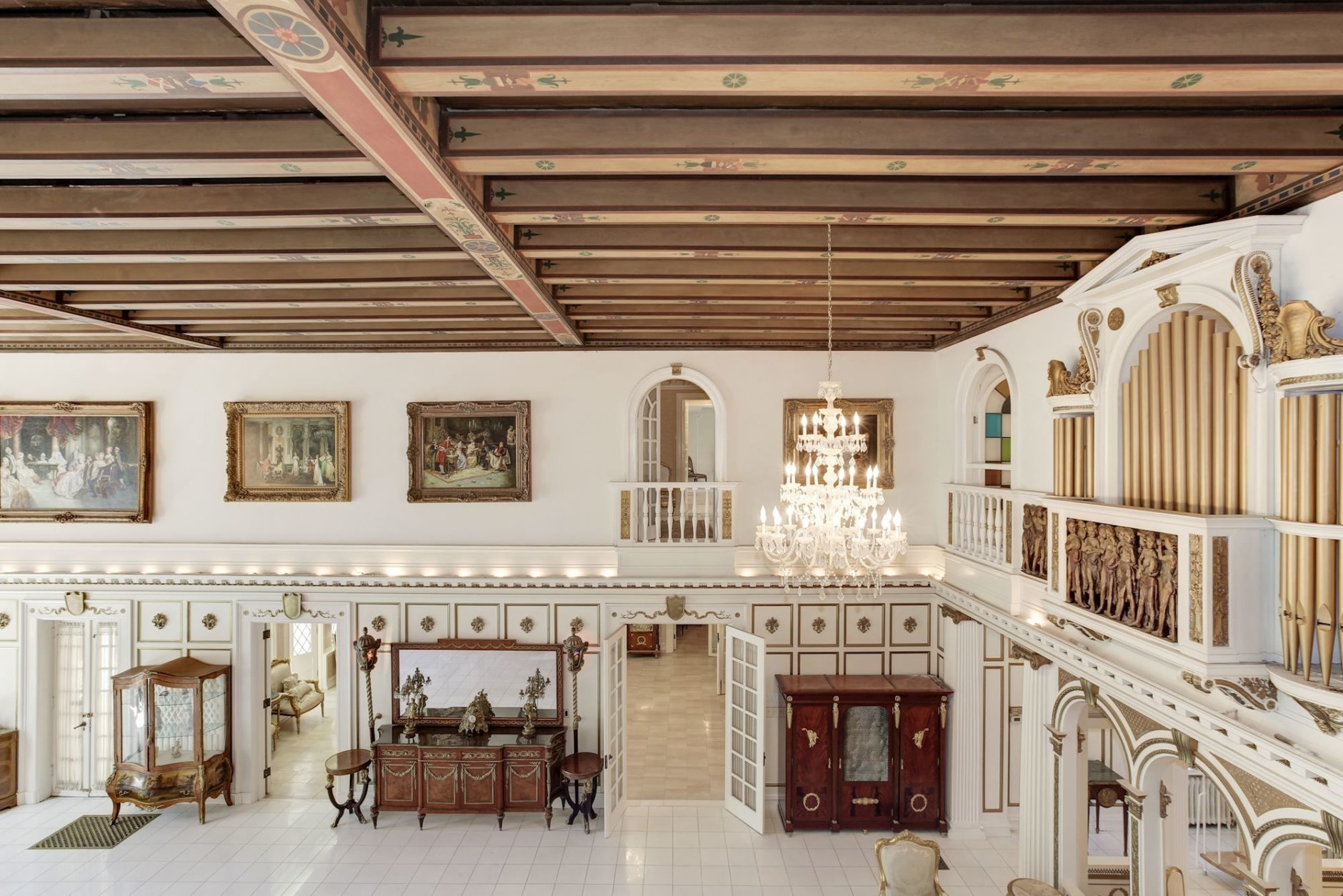 The Elizabethan-style manor has retained many of its period features and custom architectural details, including carved moldings and paneled walls. (Courtesy Long & Foster)
