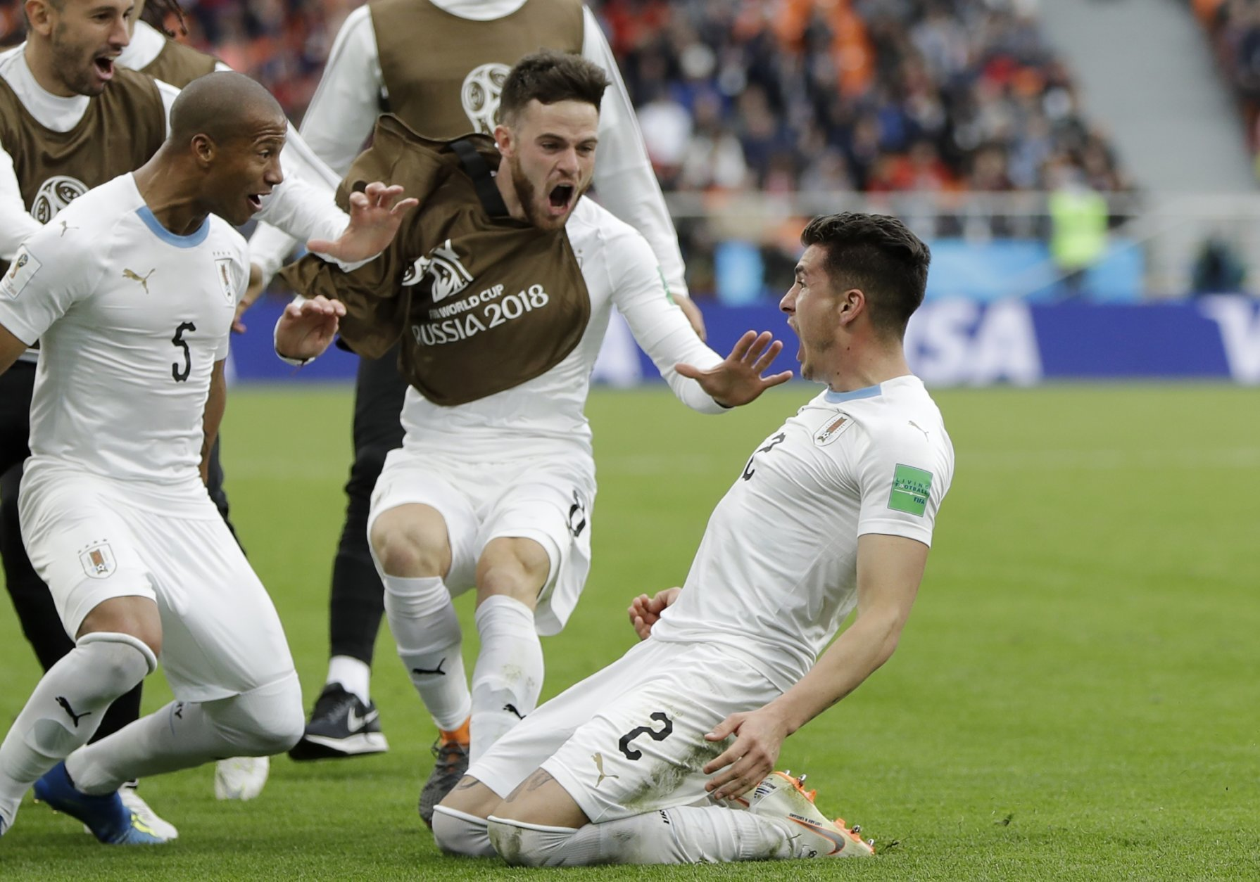 Uruguay's Jose Gimenez, right, celebrates with his teammates after scoring his side's opening goal during the group A match between Egypt and Uruguay at the 2018 soccer World Cup in the Yekaterinburg Arena in Yekaterinburg, Russia, Friday, June 15, 2018. (AP Photo/Natacha Pisarenko)