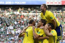 Sweden's Andreas Granqvist, left, celebrates with teammates after scoring his side's second goal during the group F match between Mexico and Sweden, at the 2018 soccer World Cup in the Yekaterinburg Arena in Yekaterinburg , Russia, Wednesday, June 27, 2018. (AP Photo/Martin Meissner)