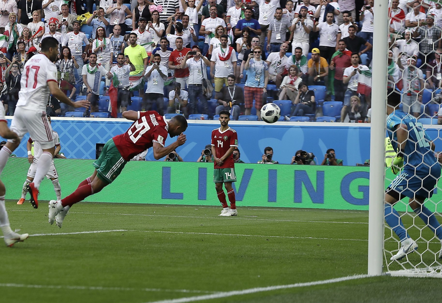 Morocco's Aziz Bouhaddouz, 20, scores an own goal during the group B match between Morocco and Iran at the 2018 soccer World Cup in the St. Petersburg Stadium in St. Petersburg, Russia, Friday, June 15, 2018. (AP Photo/Themba Hadebe)