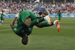 Saudi Arabia's Salem Aldawsari celebrates with a flip after scoring his side's second goal during the group A match between Saudi Arabia and Egypt at the 2018 soccer World Cup at the Volgograd Arena in Volgograd, Russia, Monday, June 25, 2018. (AP Photo/Darko Vojinovic)