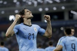 Uruguay's Edinson Cavani celebrates after scoring his side's 2nd goal during the round of 16 match between Uruguay and Portugal at the 2018 soccer World Cup at the Fisht Stadium in Sochi, Russia, Saturday, June 30, 2018. (AP Photo/Andre Penner)
