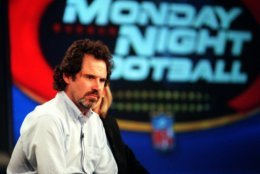 """Comedian Dennis Miller, a new addition to the announcing team of ABC's """"Monday Night Football,"""" considers a reporter's question during a news conference at the ABC 2000 Summer Press Tour in Pasadena, Calif., Sunday, July 16, 2000. (AP Photo/Chris Pizzello)"""