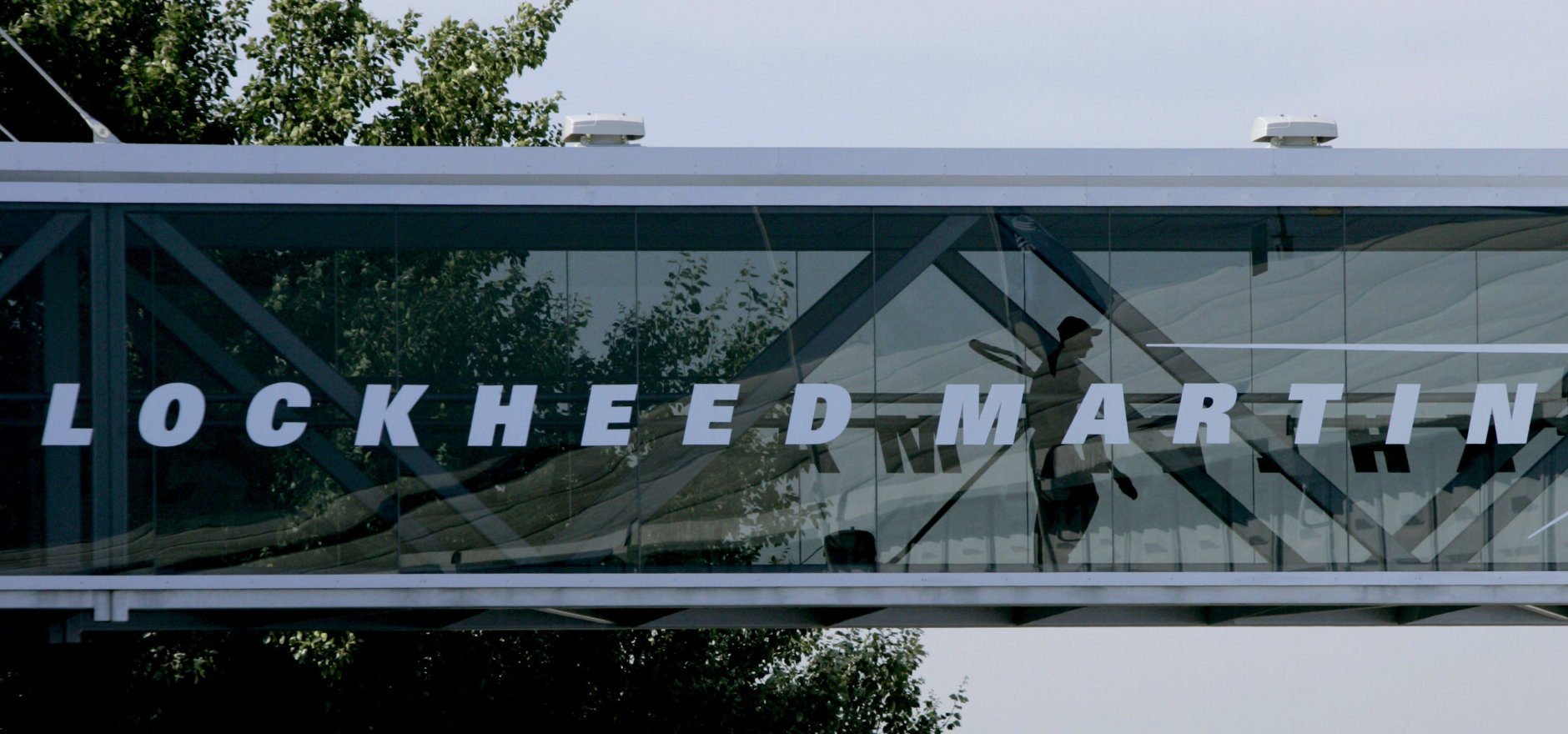 A man walks past a Lockheed Martin logo.  (AP Photo/Matt Dunham)