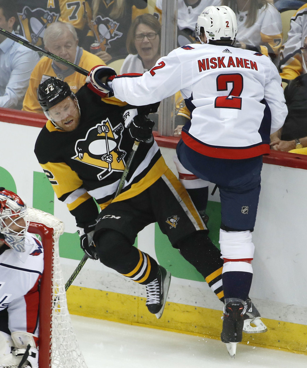 Washington Capitals' Matt Niskanen (2) collides with Pittsburgh Penguins' Patric Hornqvist (72) during the first period in Game 4 of an NHL second-round hockey playoff series in Pittsburgh, Thursday, May 3, 2018. (AP Photo/Gene J. Puskar)
