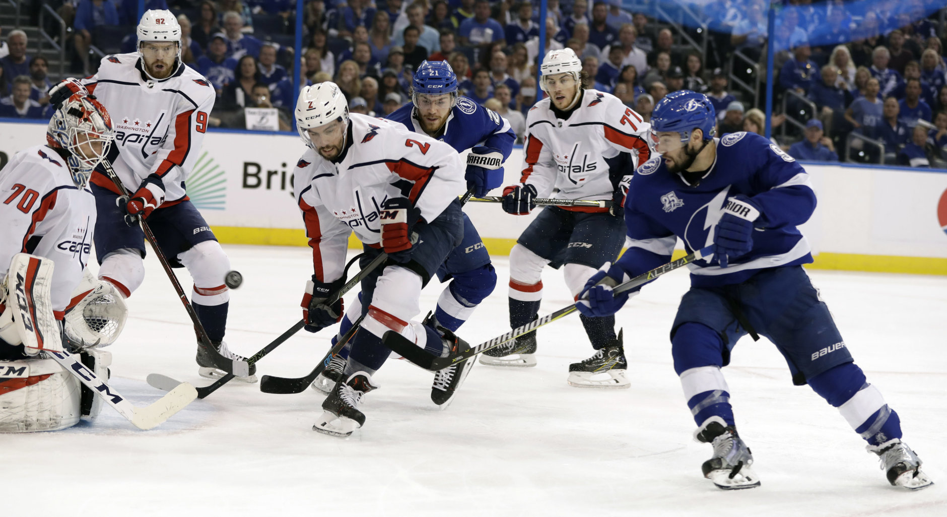 Tampa Bay Lightning center Tyler Johnson (9) gets off a shot on Washington Capitals goaltender Braden Holtby (70) as defenseman Matt Niskanen (2) and center Evgeny Kuznetsov (92) looks for a rebound during the second period of Game 5 of the NHL Eastern Conference finals hockey playoff series Saturday, May 19, 2018, in Tampa, Fla. (AP Photo/Chris O'Meara)