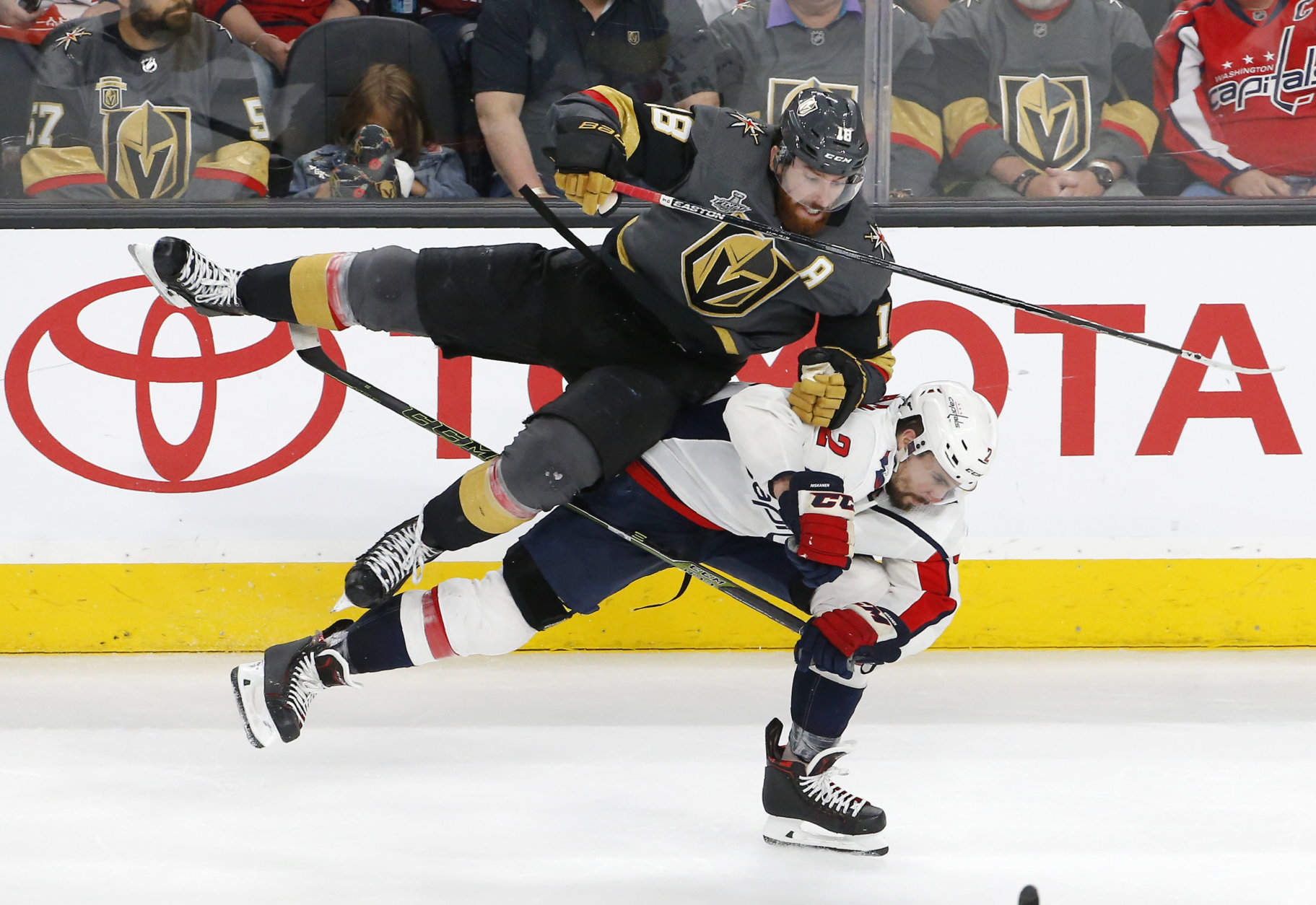 Vegas Golden Knights left wing James Neal, top, and Washington Capitals defenseman Matt Niskanen collide during the third period in Game 2 of the NHL hockey Stanley Cup Finals Wednesday, May 30, 2018, in Las Vegas. (AP Photo/Ross D. Franklin)