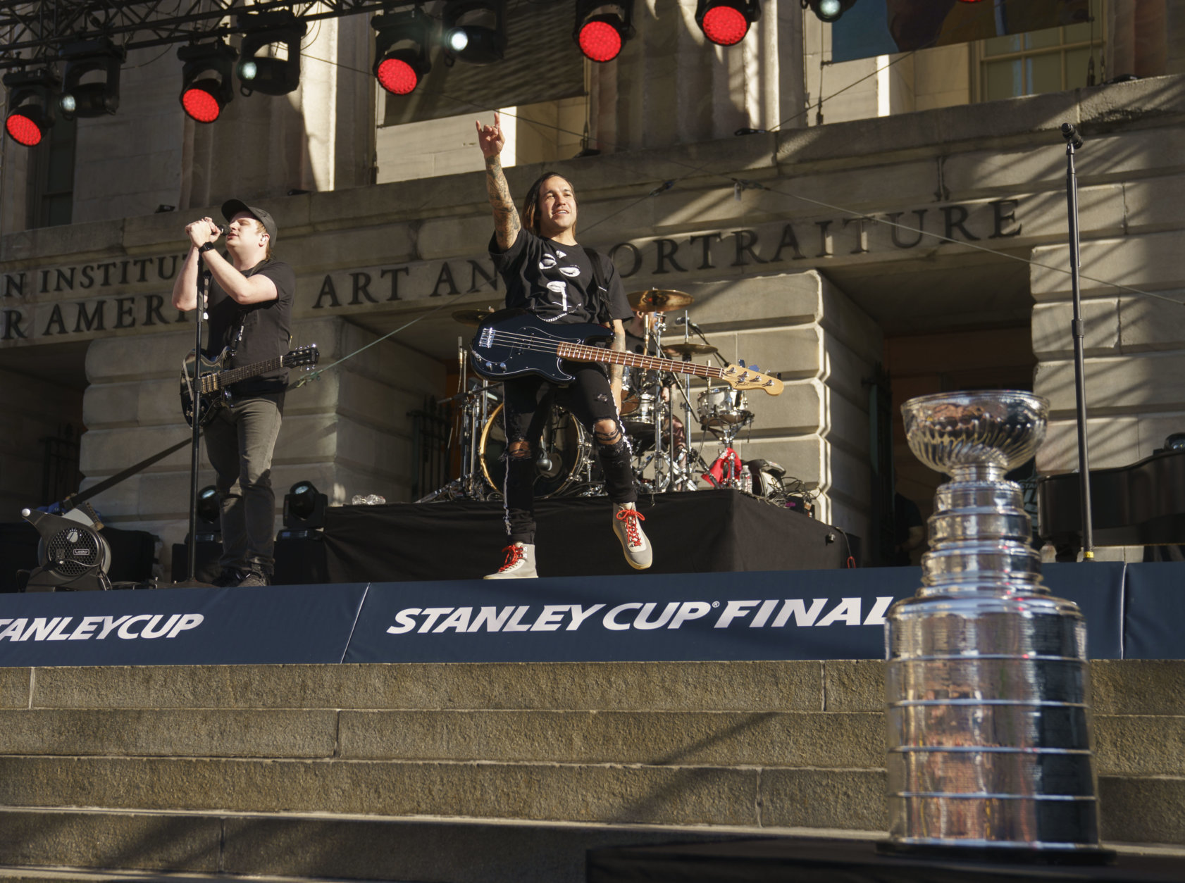 Fall Out Boy performs before the start of Game 4 of the NHL hockey Stanley Cup Final between the Washington Capitals and the Vegas Golden Knights, Monday, June 4, 2018, in Washington. The Stanley Cup is displayed lower right. (AP Photo/Carolyn Kaster)
