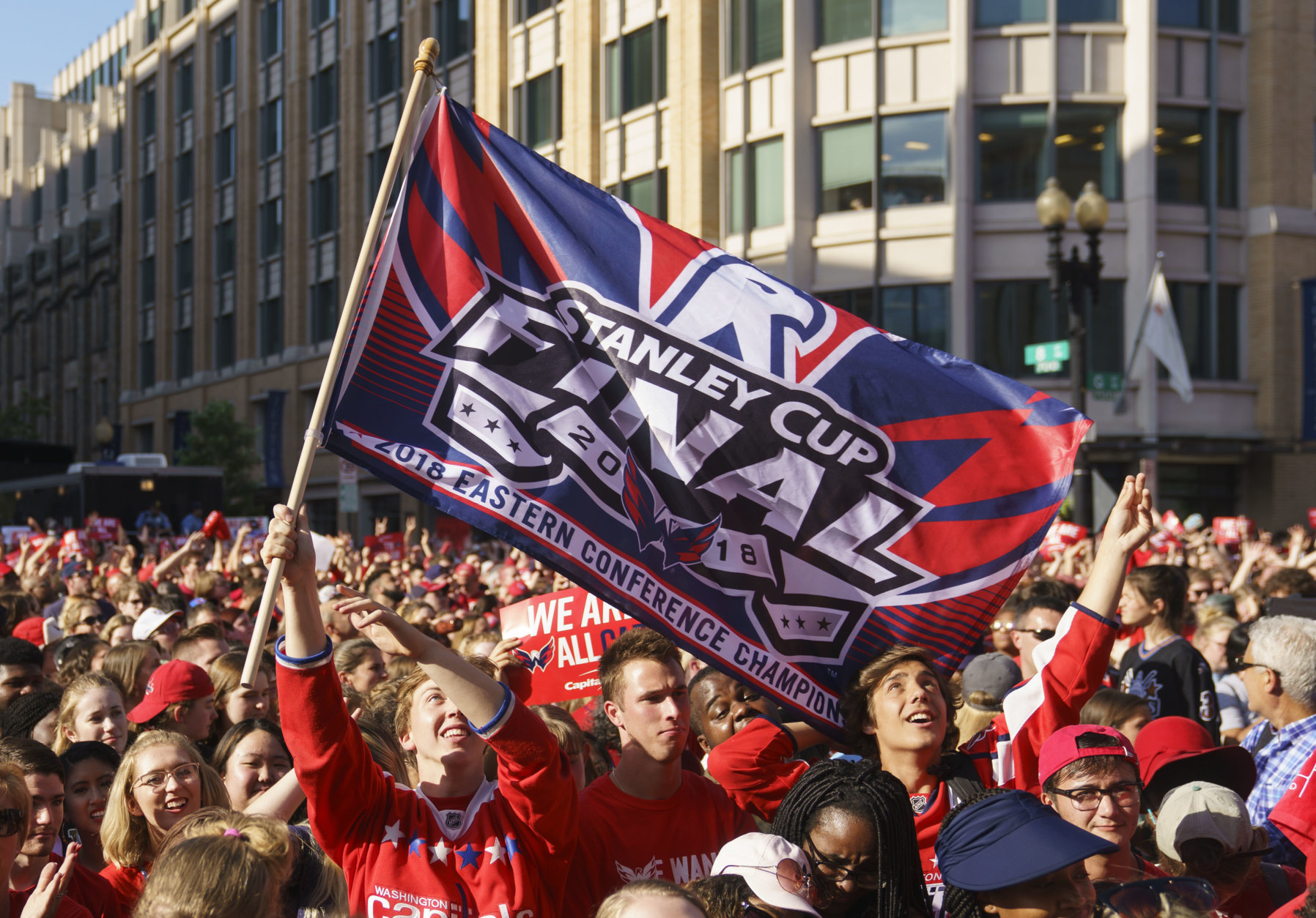 Fans cheer and wave a Stanley Cup Final flag before Game 4 of the NHL hockey Stanley Cup Final between the Washington Capitals and the Vegas Golden Knights, Monday, June 4, 2018, in Washington. (AP Photo/Carolyn Kaster)