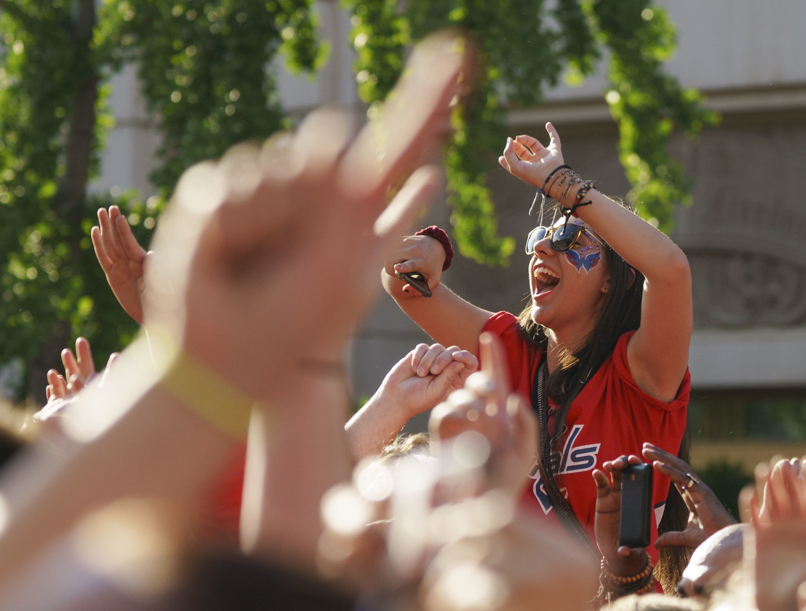 A Washington Capitals fan is held high and fans cheer during a Fall Out Boy performance before Game 4 of the NHL hockey Stanley Cup Final between the Washington Capitals and the Vegas Golden Knights, Monday, June 4, 2018, in Washington. (AP Photo/Carolyn Kaster)