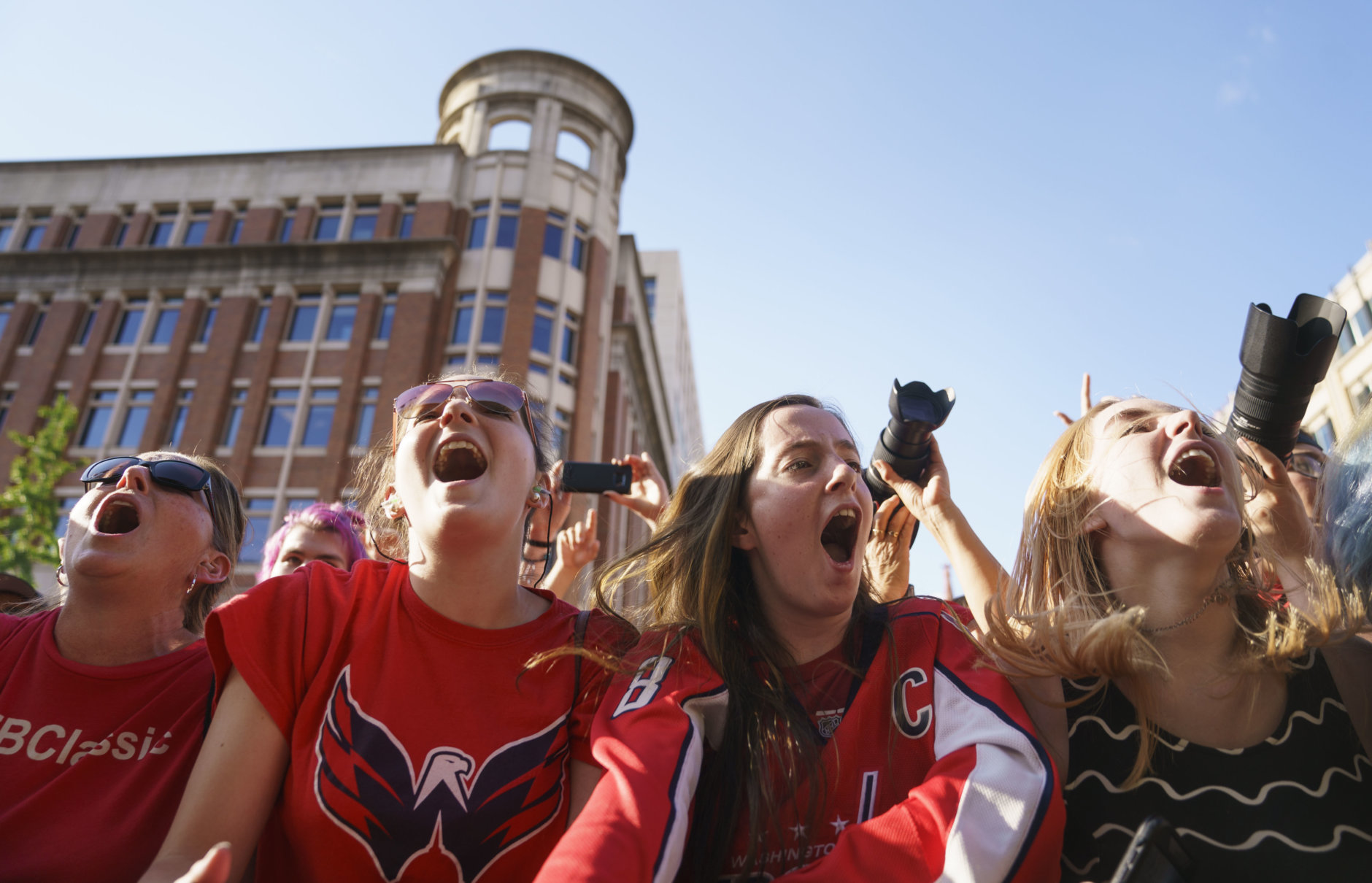 Fans cheer as Fall Out Boy performers before Game 4 of the NHL hockey Stanley Cup Final between the Washington Capitals and the Vegas Golden Knights, Monday, June 4, 2018, in Washington. (AP Photo/Carolyn Kaster)