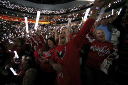 Washington Capitals fans wave wbwefore Game 4 of the NHL hockey Stanley Cup Final between the Capitals and the Vegas Golden Knights, Monday, June 4, 2018, in Washington. (AP Photo/Alex Brandon)