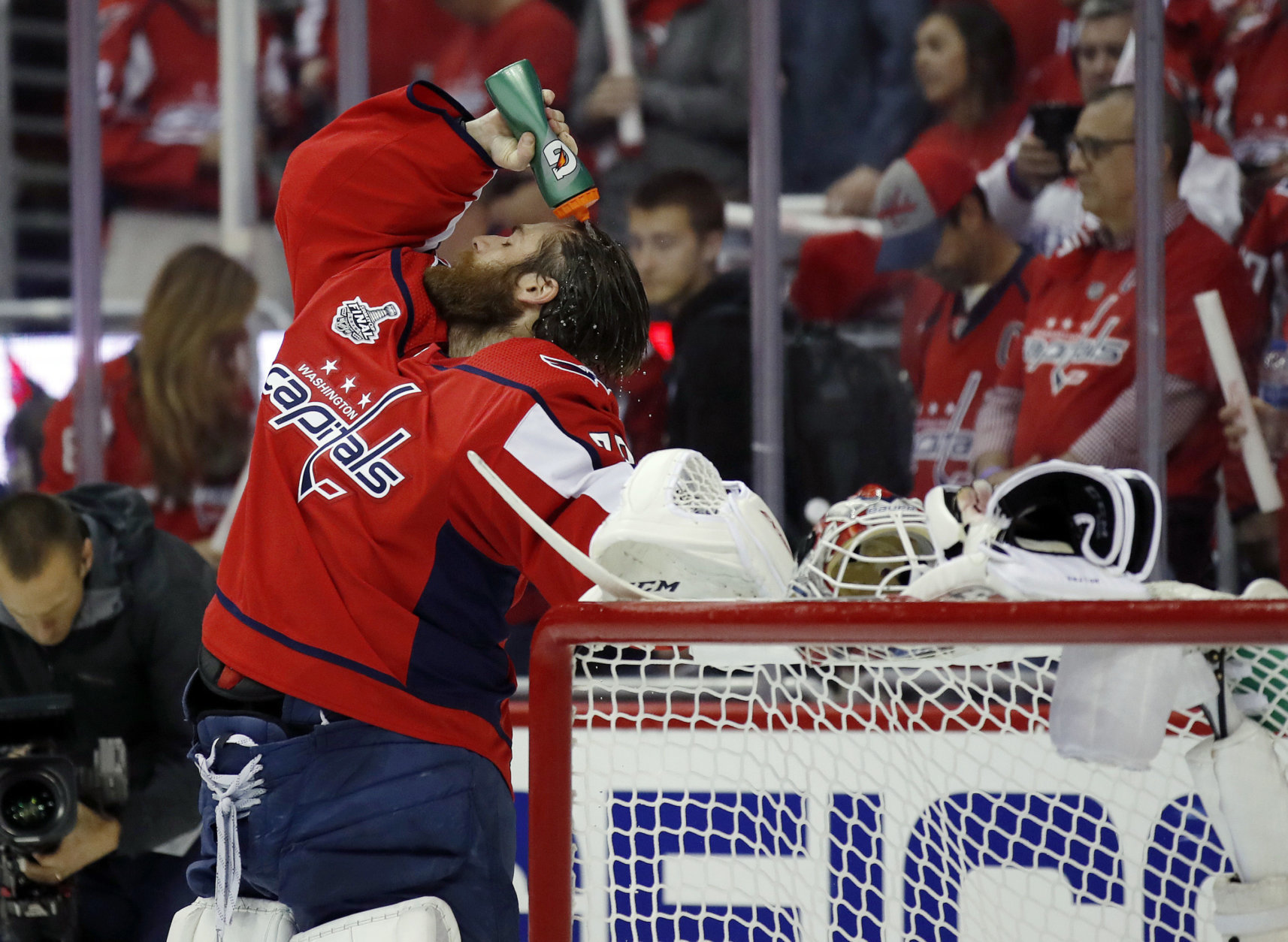 Washington Capitals goaltender Braden Holtby douses himself before Game 4 of the NHL hockey Stanley Cup Final against the Vegas Golden Knights, Monday, June 4, 2018, in Washington. (AP Photo/Alex Brandon)