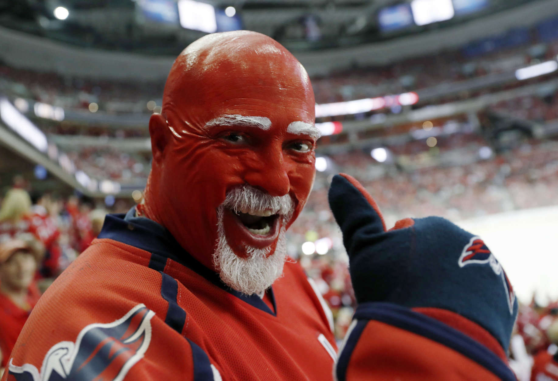 A Washington Capitals fan wears team colors during the first period in Game 4 of the NHL hockey Stanley Cup Final between the Capitals and the Vegas Golden Knights, Monday, June 4, 2018, in Washington. (AP Photo/Pablo Martinez Monsivais)