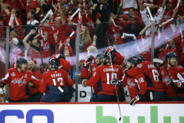 Washington Capitals players and fans celebrate one of their three goals against the Vegas Golden Knights during the first period in Game 4 of the NHL hockey Stanley Cup Final, Monday, June 4, 2018, in Washington. (AP Photo/Alex Brandon)