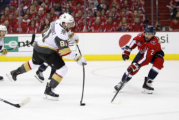 Vegas Golden Knights forward Jonathan Marchessault (81) shoots against Washington Capitals defenseman Matt Niskanen (2) during the first period in Game 4 of the NHL hockey Stanley Cup Final, Monday, June 4, 2018, in Washington. (AP Photo/Alex Brandon)