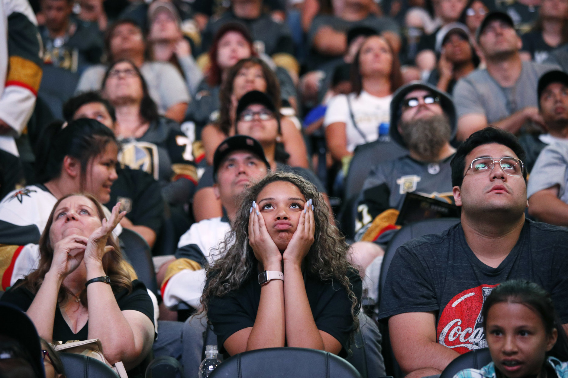 Kayla Tyus, center, reacts as the Vegas Golden Knights trail the Washington Capitals during a watch party for Game 4 of the NHL hockey Stanley Cup Final, Monday, June 4, 2018, in Las Vegas. (AP Photo/John Locher)