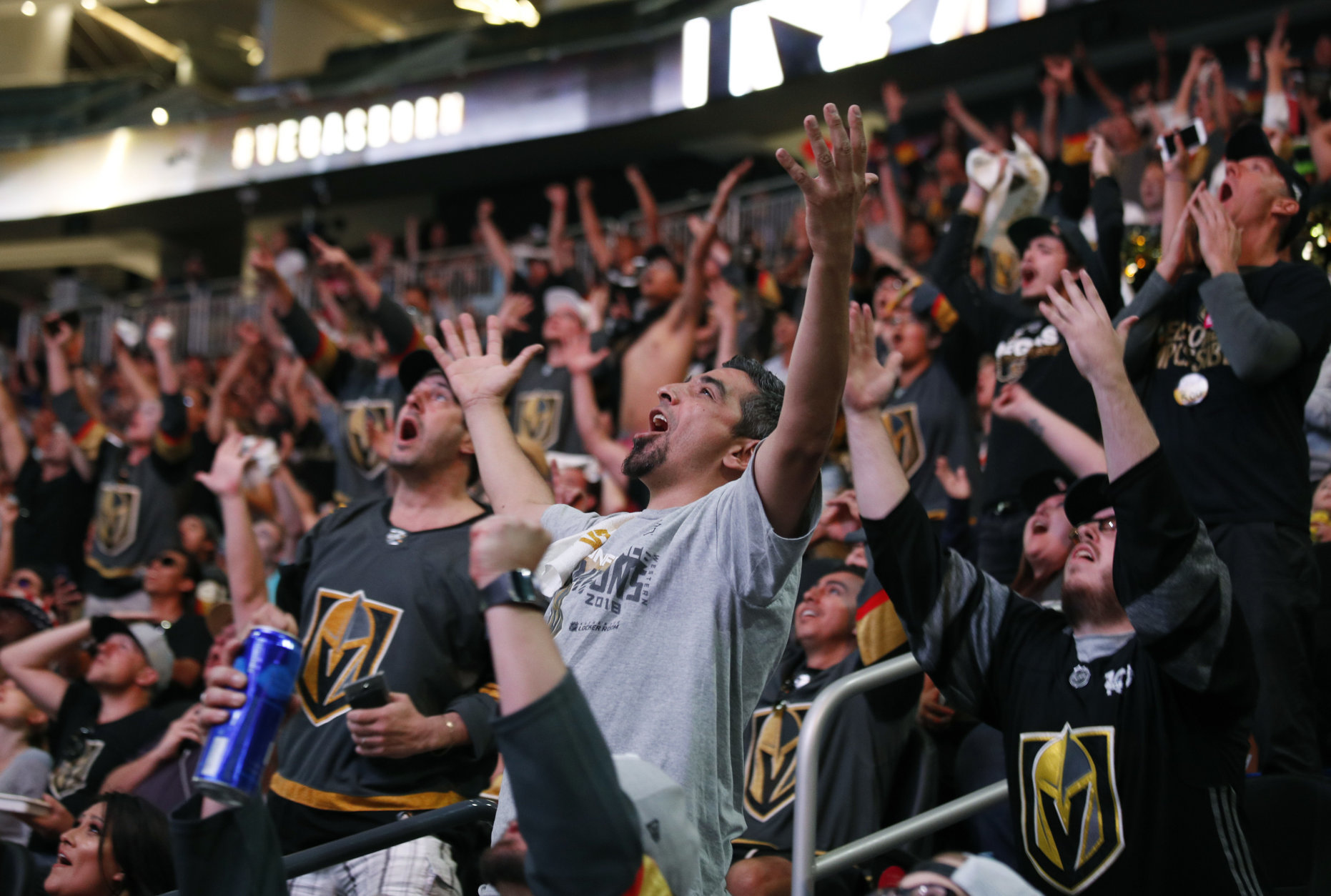 Fans cheer during a watch party for Game 4 of the NHL hockey Stanley Cup Final between the Washington Capitals and the Vegas Golden Knights, Monday, June 4, 2018, in Las Vegas. (AP Photo/John Locher)