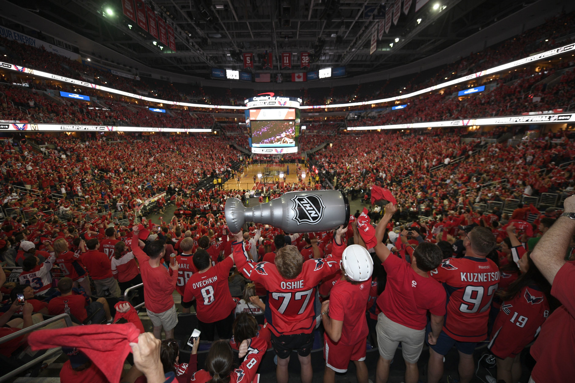 Fans react at a viewing party for Game 5 of the NHL hockey Stanley Cup Final between the Washington Capitals and the Vegas Golden Knights, Thursday, June 7, 2018, in Washington. (AP Photo/Nick Wass)