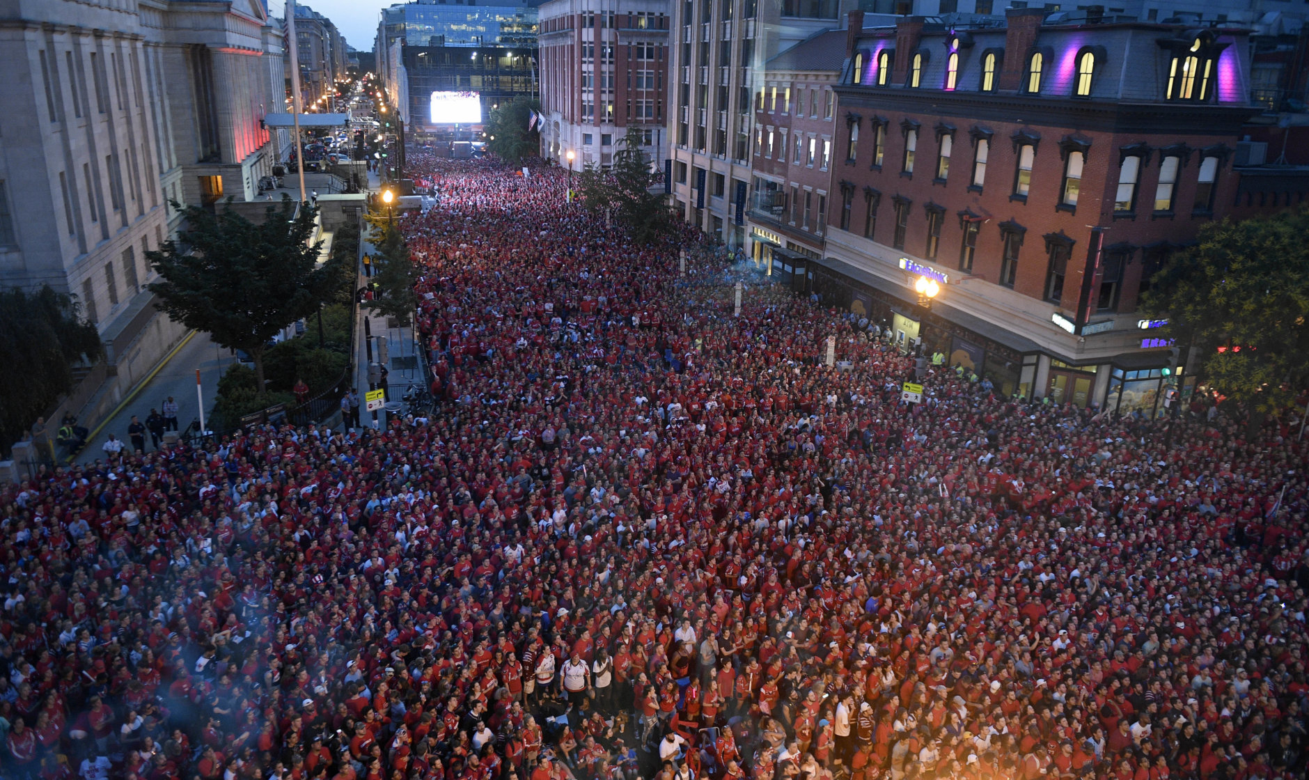 Fans gather outside Capital One Arena at a viewing party for Game 5 of the NHL hockey Stanley Cup Finals between the Washington Capitals and the Vegas Golden Knights, Thursday, June 7, 2018, in Washington. (AP Photo/Nick Wass)