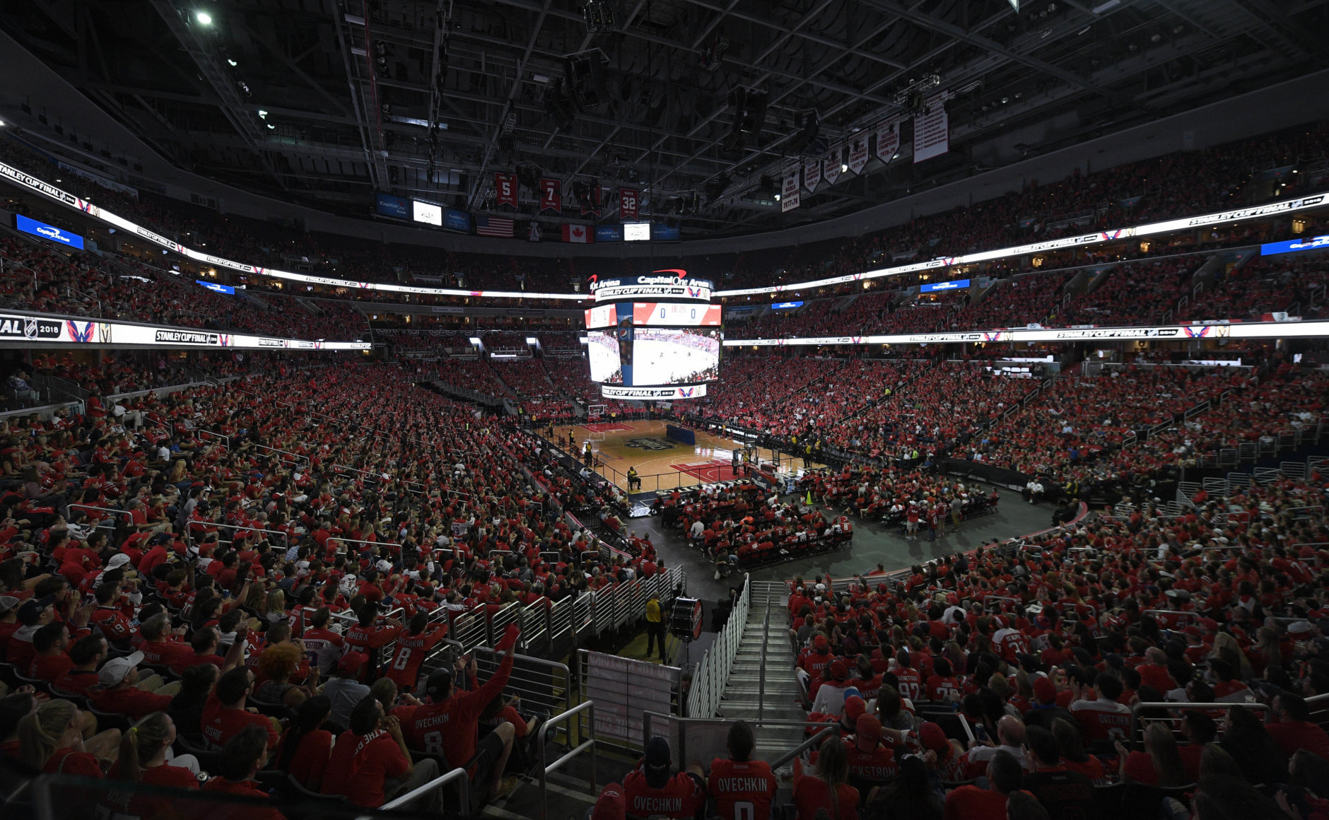 Fans attend a viewing party for Game 5 of the NHL hockey Stanley Cup Final between the Washington Capitals and the Vegas Golden Knights, Thursday, June 7, 2018, in Washington. (AP Photo/Nick Wass)