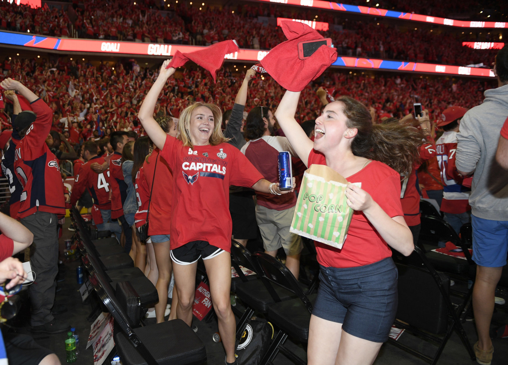 Fans at a viewing party react to a goal by Washington Capitals' Jakub Vrana during Game 5 of the NHL hockey Stanley Cup Final between the Capitals and the Vegas Golden Knights, Thursday, June 7, 2018, in Washington. (AP Photo/Nick Wass)