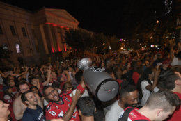 Washington Capitals fans celebrate in the streets outside Capital One Arena after Game 5 of the NHL hockey Stanley Cup Final between the Washington Capitals and the Vegas Golden Knights in Las Vegas, Thursday, June 7, 2018, in Washington. The Capitals won the Stanley Cup with a 4-3 win Thursday night. (AP Photo/Nick Wass)