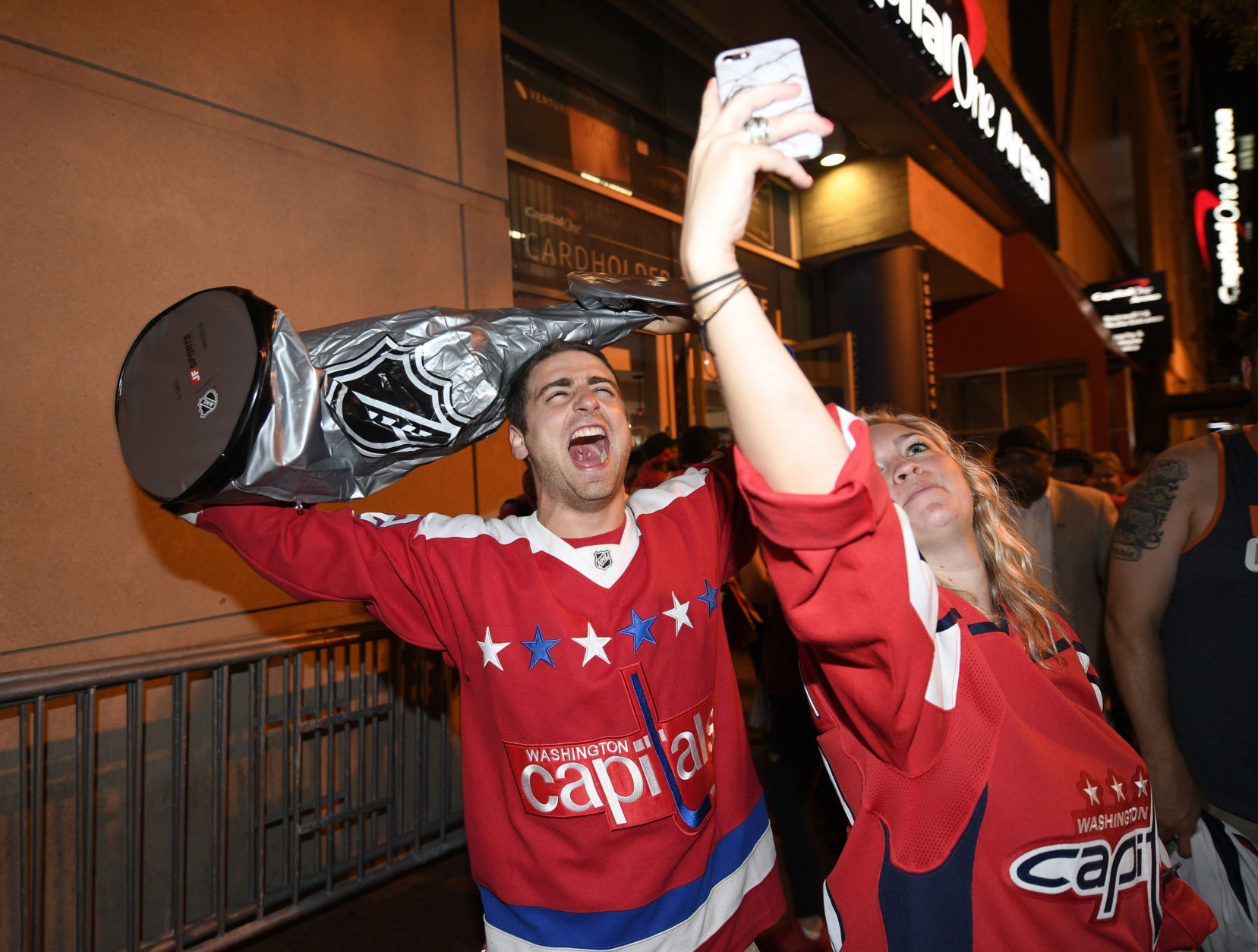 Washington Capitals fans celebrate in the streets outside Capital One Arena in Washington after Game 5 of the NHL hockey Stanley Cup Final between the Washington Capitals and the Vegas Golden Knights in Las Vegas, Thursday, June 7, 2018. The Capitals won the Stanley Cup. (AP Photo/Nick Wass)