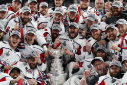 Members of the Washington Capitals pose with the Stanley Cup after the Capitals defeated the Golden Knights 4-3 in Game 5 of the NHL hockey Stanley Cup Finals Thursday, June 7, 2018, in Las Vegas. (AP Photo/John Locher)