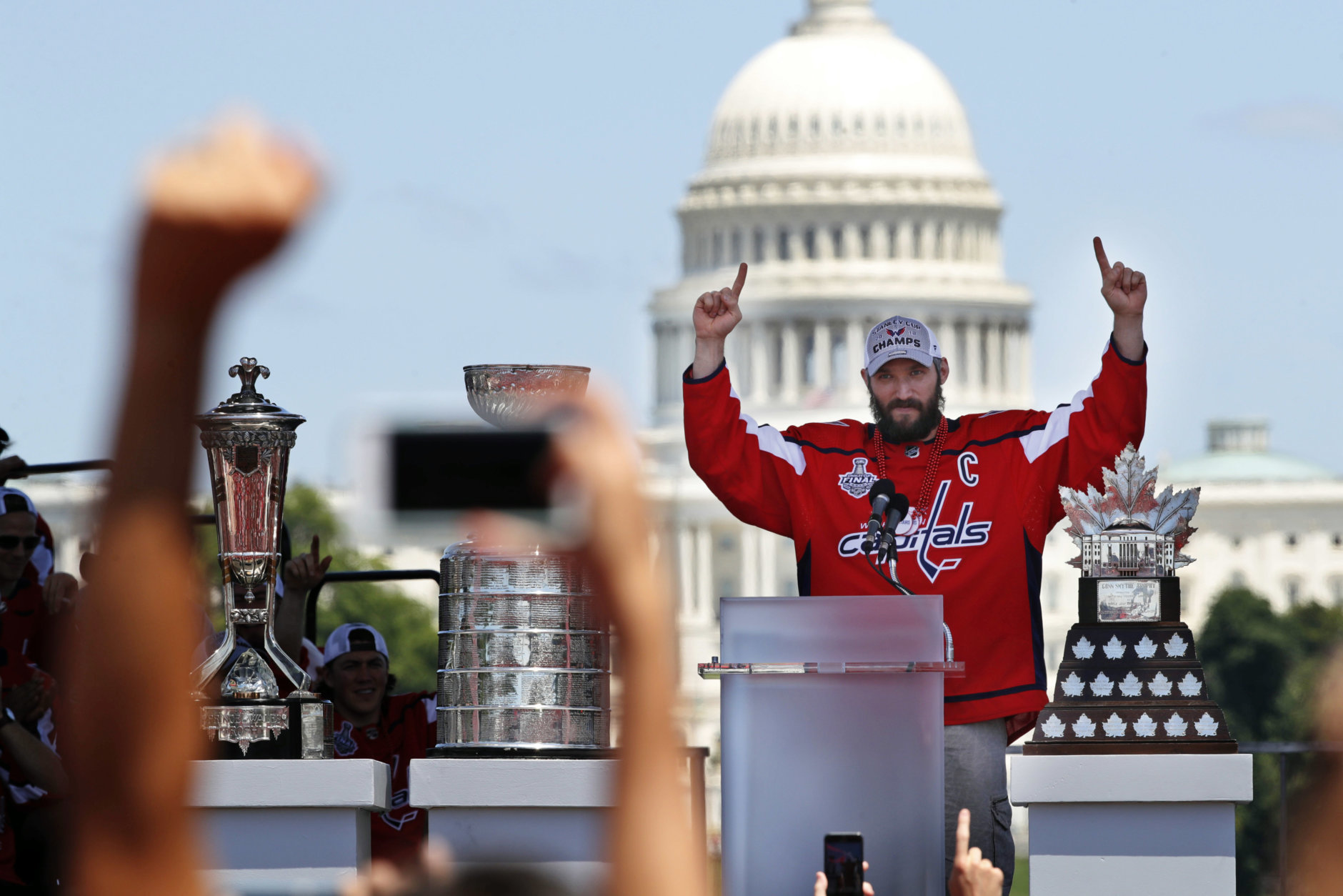 Washington Capitals Alex Ovechkin, from Russia, gestures during the NHL hockey team's Stanley Cup victory celebration, Tuesday, June 12, 2018, on the National Mall in Washington. The U.S. Capitol rises n the background(AP Photo/Jacquelyn Martin)
