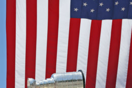 Washington Capitals left wing Alex Ovechkin (8), from Russia, holds up the Stanley Cup, with center Nicklas Backstrom (19), from Sweden, left, and owner Ted Leonsis, right, during a victory parade, Tuesday, June 12, 2018, in Washington. (AP Photo/Alex Brandon, Pool)