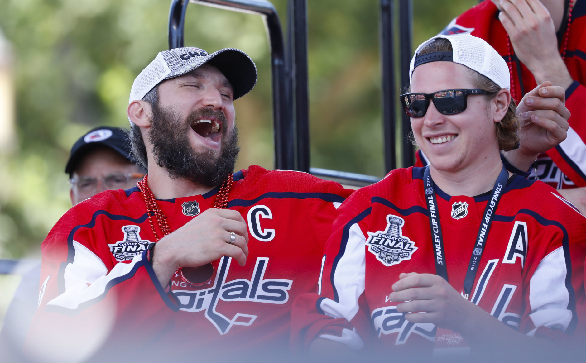 Washington Capitals forward Alex Ovechkin (8), of Russia, left, laughs as he sits next to teammate, forward Nicklas Backstrom (19), of Sweden, right, while on stage during the Stanley Cup victory celebration on the National Mall in Washington, Tuesday, June 12, 2018. (AP Photo/Pablo Martinez Monsivais)