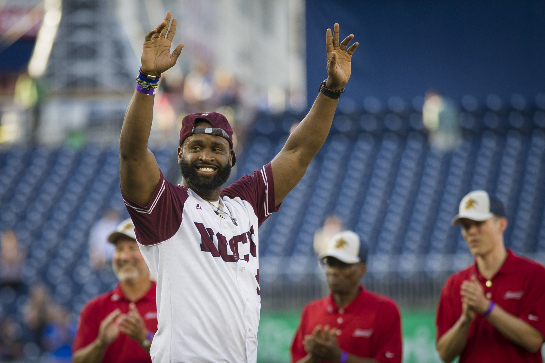 Capitol Police Special Agent David Bailey celebrates after throwing out the first pitch to start the 57th Congressional Baseball Game at National's Park in Washington, Thursday, June 14, 2018. On June 14, 2017, Congressional members were victims of a shooting at the baseball field they were practicing on in Alexandria, Va. (AP Photo/Cliff Owen)