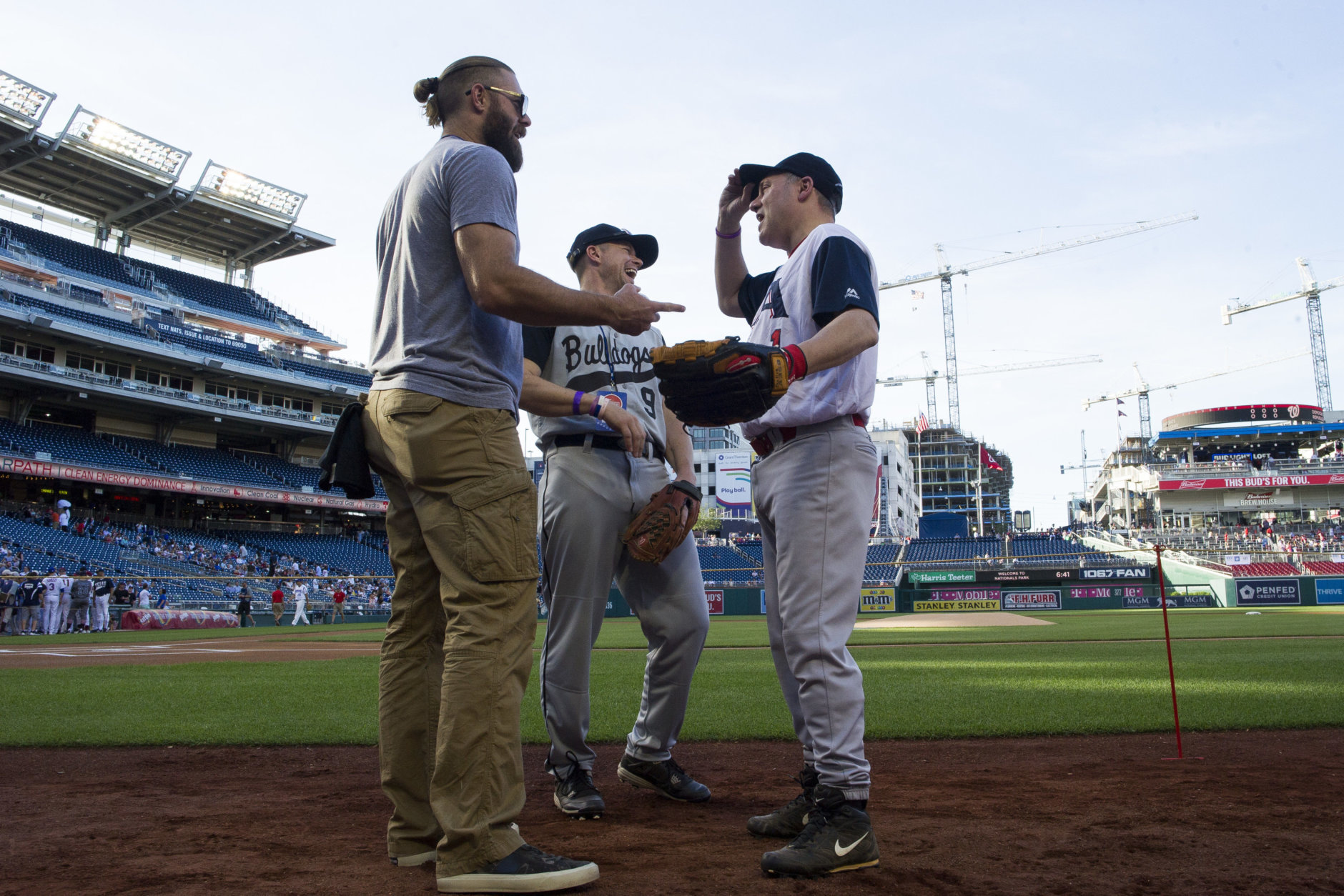 U.S. Rep. Steve Scalise, R-Louisiana, right, talks with Washington Nationals outfielder Jayson Werth, left, before the start of the 57th Congressional Baseball Game at National's Park in Washington, Thursday, June 14, 2018. On June 14, 2017, Congressional members were victims of a shooting at the baseball field they were practicing on in Alexandria, Va. (AP Photo/Cliff Owen)