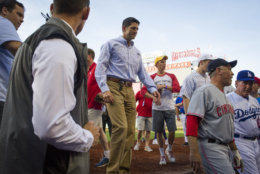 Speaker of the House Paul Ryan, of Wisconsin, walks into the Republican team dugout at the start of the 57th Congressional Baseball Game at National's Park in Washington, Thursday, June 14, 2018. On June 14, 2017, Congressional members were victims of a shooting at the baseball field they were practicing on in Alexandria, Va. (AP Photo/Cliff Owen)
