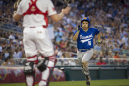 U.S. Rep. Raul Ruiz, D-California, runs for home plate after stealing home base in the fifth inning of the 57th Congressional Baseball Game at National's Park in Washington, Thursday, June 14, 2018. On June 14, 2017, Congressional members were victims of a shooting at the baseball field they were practicing on in Alexandria, Va. (AP Photo/Cliff Owen)