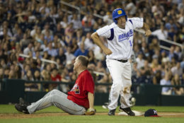 Rep. Tim Ryan, D-Ohio, right, heads for home plate after colliding with Rep. Trent Kelly, R-Miss., after Ryan stole third base during the 57th Congressional Baseball Game at National's Park in Washington, Thursday, June 14, 2018. Members of Congress played their annual baseball game Thursday night - a year after some Republican players and others were wounded in a shooting spree at a team practice in Virginia. (AP Photo/Cliff Owen)