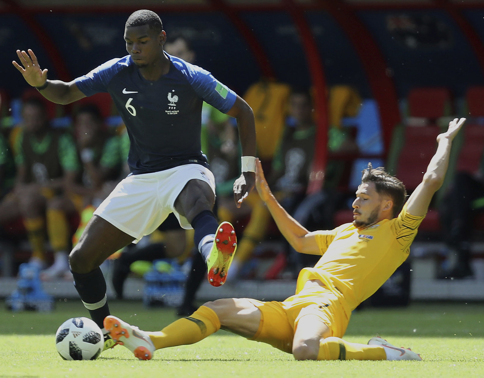 France's Paul Pogba, left, and Australia's Mathew Leckie, right, challenge the ball during the group C match between France and Australia at the 2018 soccer World Cup in the Kazan Arena in Kazan, Russia, Saturday, June 16, 2018. (AP Photo/David Vincent)