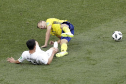 South Korea's Kim Min-woo, bottom, and Sweden's Viktor Claesson fall on the pitch during the group F match between Sweden and South Korea at the 2018 soccer World Cup in the Nizhny Novgorod stadium in Nizhny Novgorod, Russia, Monday, June 18, 2018. (AP Photo/Michael Sohn)