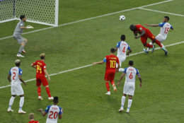 Belgium's Romelu Lukaku, top second right, heads the ball to score his side's second goal during the group G match between Belgium and Panama at the 2018 soccer World Cup in the Fisht Stadium in Sochi, Russia, Monday, June 18, 2018. (AP Photo/Victor R. Caivano)
