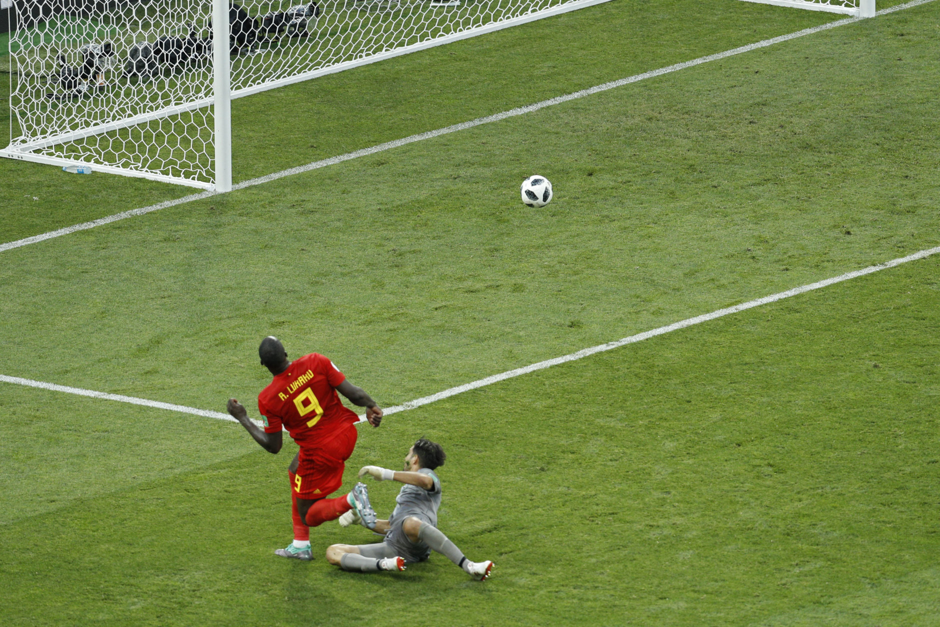 Belgium's Romelu Lukaku, left, scores past Panama goalkeeper Jaime Penedo his side's third goal during the group G match between Belgium and Panama at the 2018 soccer World Cup in the Fisht Stadium in Sochi, Russia, Monday, June 18, 2018. Belgium won 3-0. (AP Photo/Victor R. Caivano)