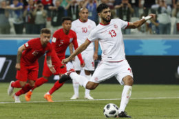 Tunisia's Ferjani Sassi scores from the penalty spot during the group G match against England at the 2018 soccer World Cup in the Volgograd Arena in Volgograd, Russia, Monday, June 18, 2018. (AP Photo/Alastair Grant)