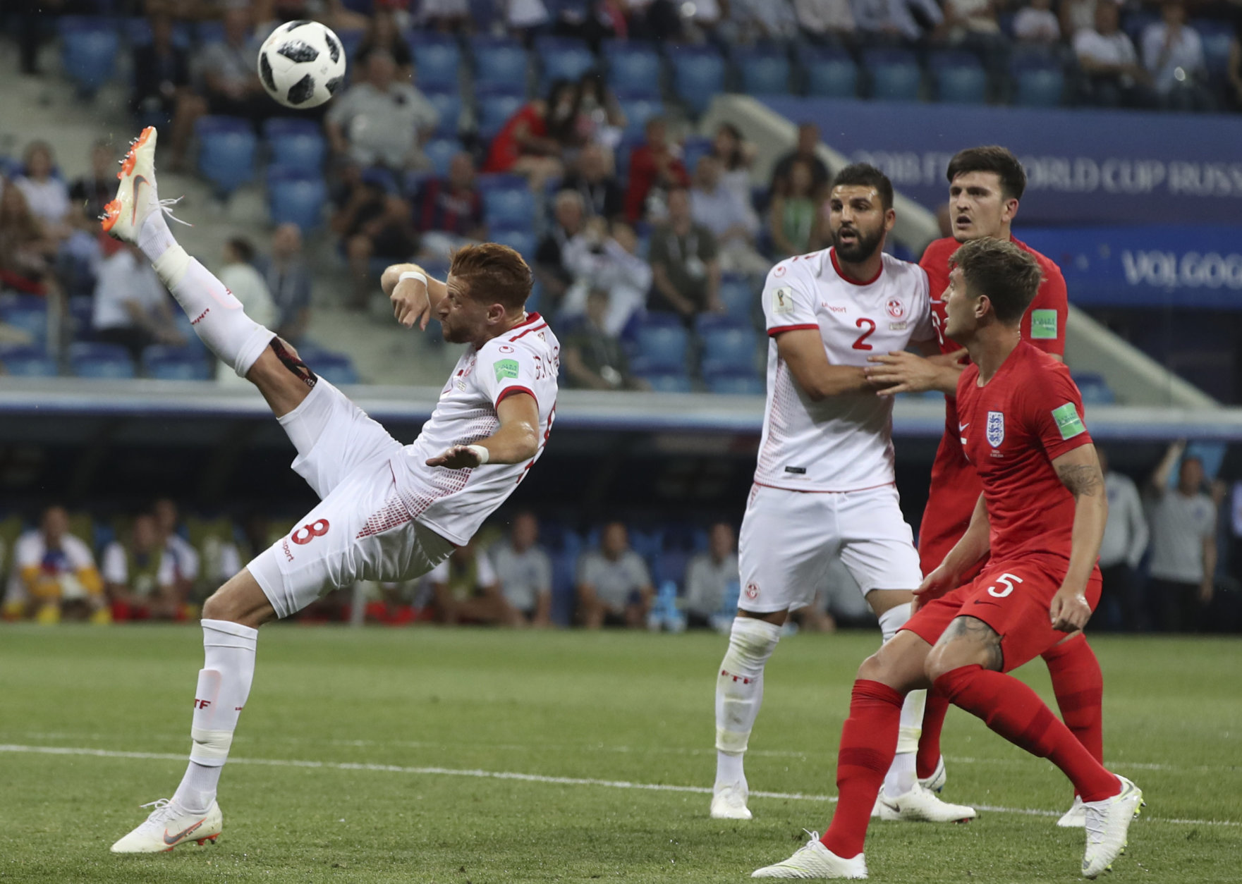 Tunisia's Fakhreddine Ben Youssef, left, kicks the ball during the group G match between Tunisia and England at the 2018 soccer World Cup in the Volgograd Arena in Volgograd, Russia, Monday, June 18, 2018. (AP Photo/Thanassis Stavrakis)