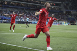 England's Harry Kane celebrates after scoring during the group G match between Tunisia and England at the 2018 soccer World Cup in the Volgograd Arena in Volgograd, Russia, Monday, June 18, 2018. (AP Photo/Thanassis Stavrakis)
