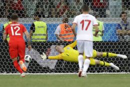 England goalkeeper Jordan Pickford, misses the ball during the group G match between Tunisia and England at the 2018 soccer World Cup in the Volgograd Arena in Volgograd, Russia, Monday, June 18, 2018. (AP Photo/Sergei Grits)