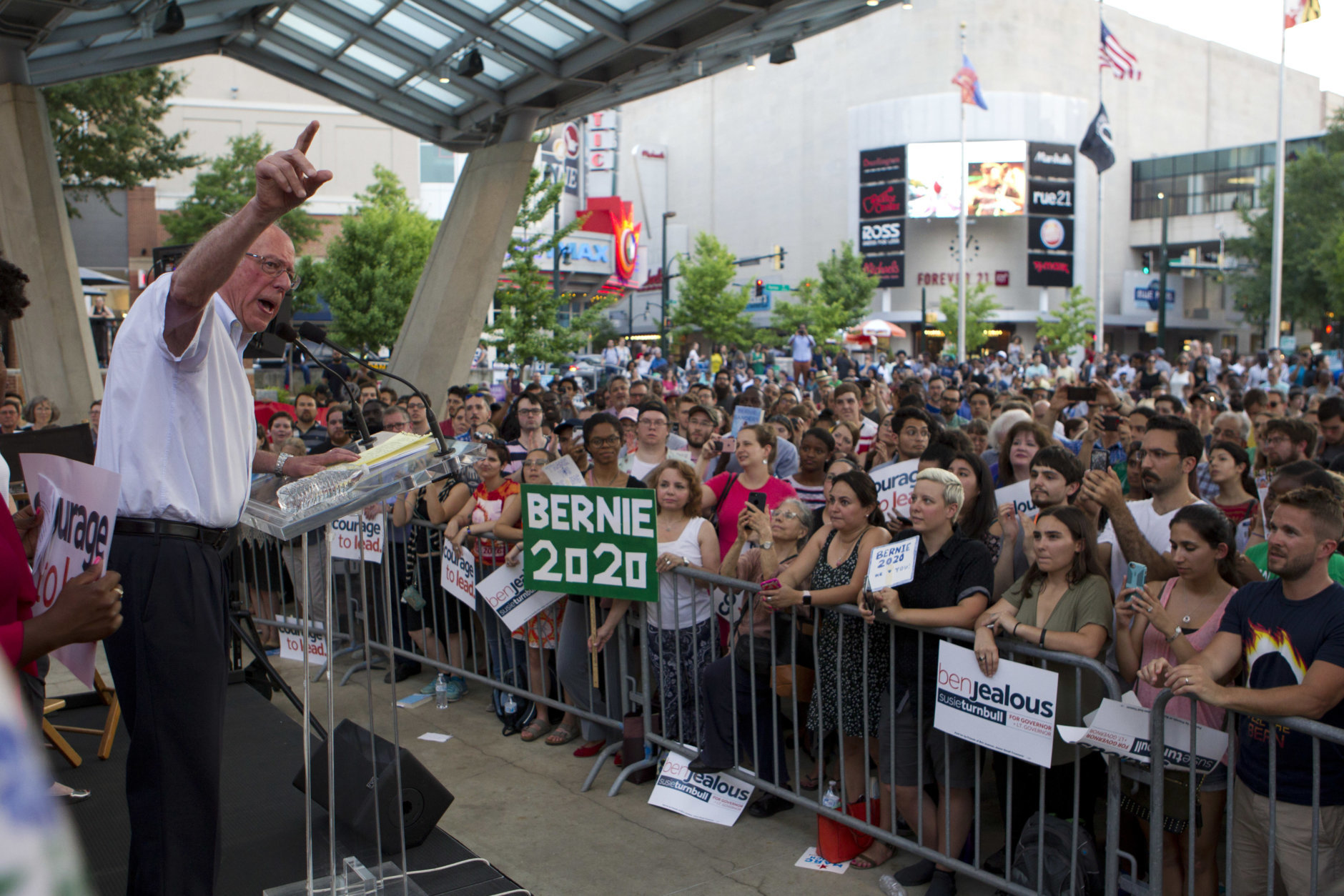 Sen. Bernie Sanders, I-Vt., accompanied by Democrat Ben Jealous speaks to the crowd during a gubernatorial campaign rally in Maryland's Democratic primary in downtown Silver Spring, Md., Monday, June 18, 2018. Sanders may not be endorsing his own son's congressional bid, but he rallied on a hot Monday night in Maryland to fire up voters for Jealous' campaign for governor. (AP Photo/Jose Luis Magana)