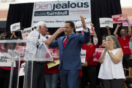 Sen. Bernie Sanders, I-Vt., greets Maryland Democratic gubernatorial candidate Ben Jealous as running mate Susie Turnbull looks on during a campaign rally in Maryland's Democratic primary in downtown Silver Spring, Md., Monday, June 18, 2018. (AP Photo/Jose Luis Magana)