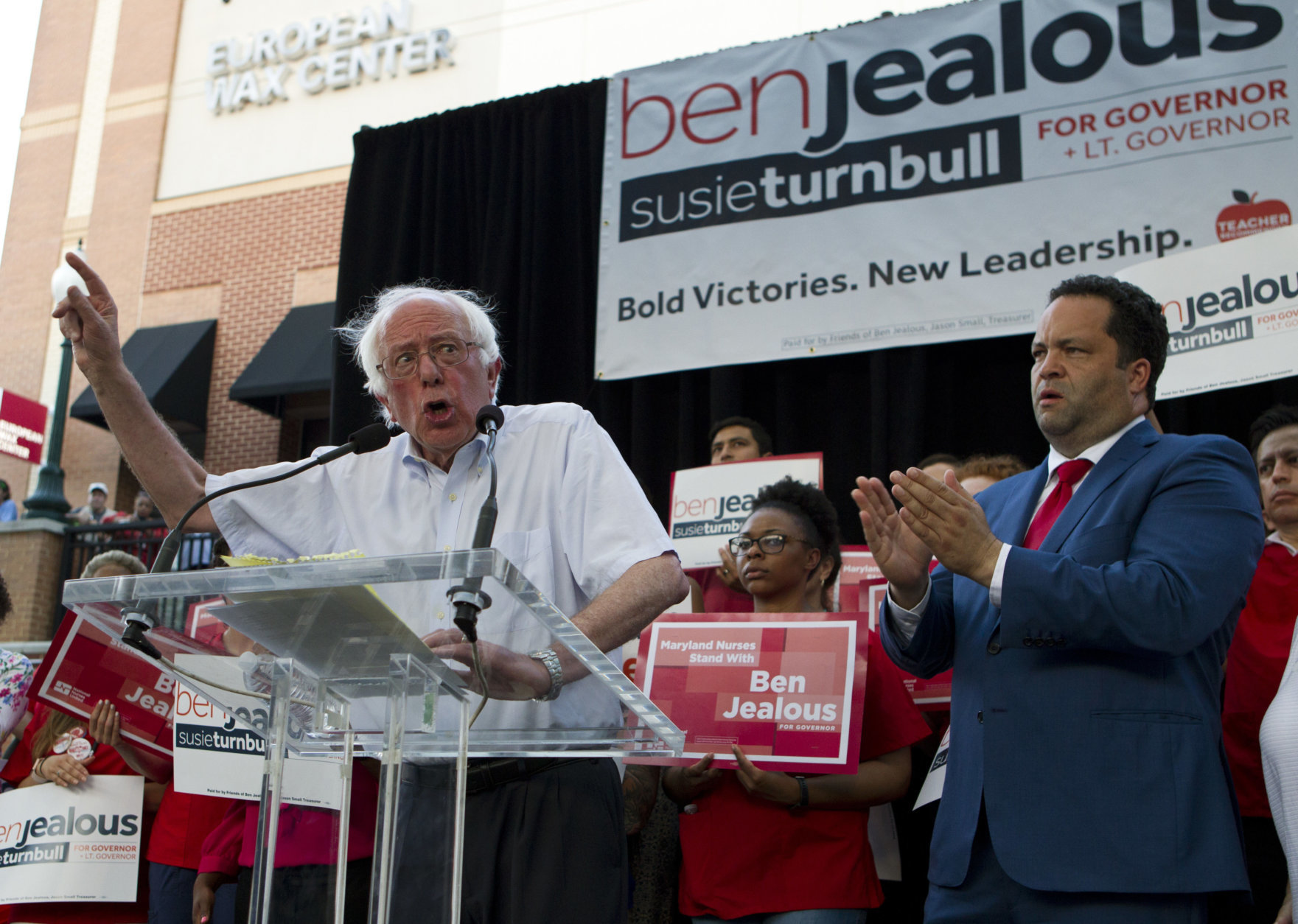 Sen. Bernie Sanders, I-Vt., accompanied by Democrat Ben Jealous, speaks to the crowd during a gubernatorial campaign rally in Maryland's Democratic primary at downtown Silver Spring, Md., Monday, June 18, 2018. (AP Photo/Jose Luis Magana)